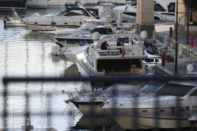 Police and security officers search Yorgen Fenech's yacht in Portomaso