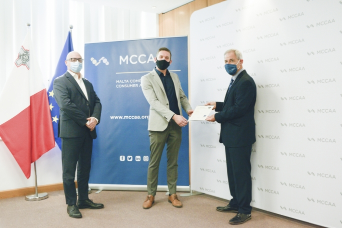 Left to right: George Cutajar, Director, Standardization Directorate, Standards and Metrology Institute; Deniss Berezins, HR Services Manager, IRIS THAUMAS LTD;  and Ing. Francis Farrugia, Director General, Standards and Metrology at MCCAA