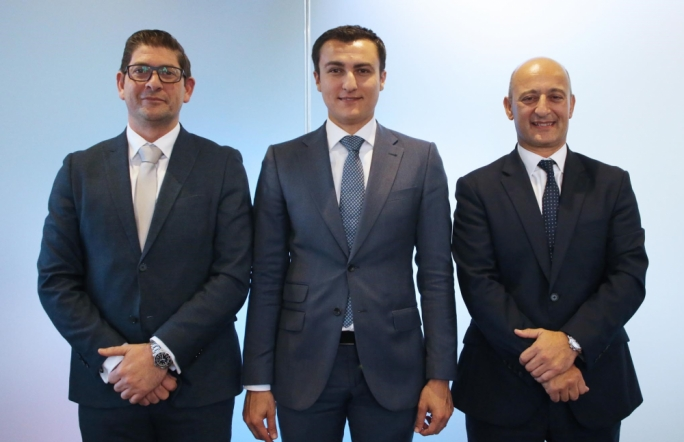 Silvio Schembri (centre) with the outgoing Chairman of FinanceMalta Kenneth Farrugia  and the newly-appointed Chairman Rudolph Psaila (left)