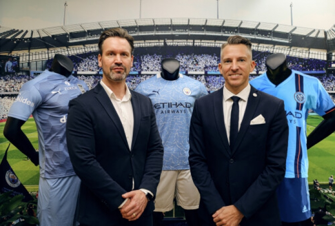 Left to right: Brando Brandstaeter, Head of Brands & Communications, Midea Group's International Business Division with Stephan Cieplik, SVP of Global Partnerships, City Football Group at the signing of the partnership expansion in Shanghai in December 2020